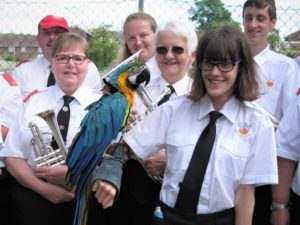 Beth and others with Macaw